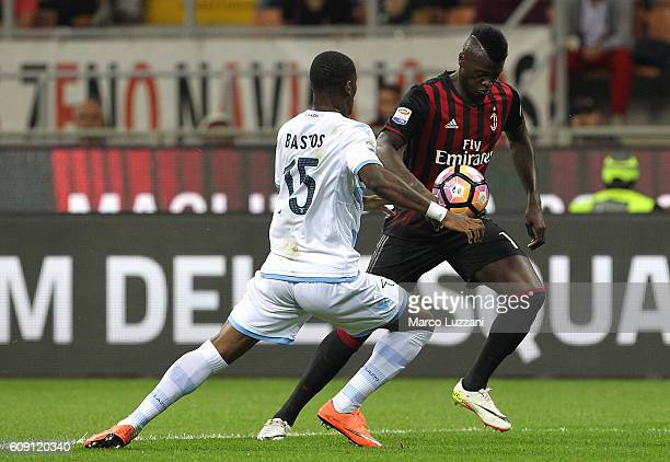 Baye Niang of AC Milan competes for the ball with Bastos of SS Lazio during the Serie A match between AC Milan and SS Lazio at Stadio Giuseppe Meazza...