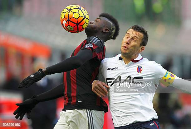Baye Niang of AC Milan competes for the ball with Daniele Gastaldello of Bologna FC during the Serie A match between AC Milan and Bologna FC at...