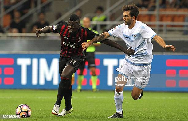 Baye Niang of AC Milan competes for the ball with Danilo Cataldi of SS Lazio during the Serie A match between AC Milan and SS Lazio at Stadio...
