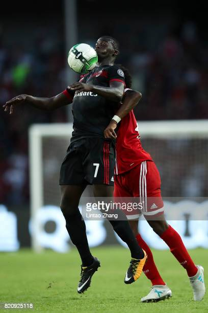 Baye Niang of AC Milan competes for the ball with Javi Martinez of FC Bayern during the 2017 International Champions Cup China match between FC...