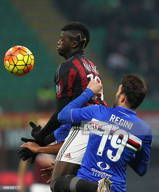 Baye Niang of AC Milan competes for the ball with Vasco Regini of UC Sampdoria during the Serie A match between AC Milan and UC Sampdoria at Stadio...