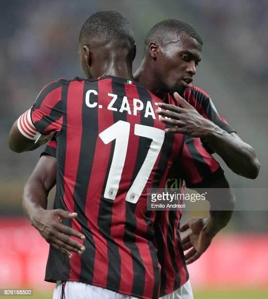 Baye Niang of AC Milan embraces his teammate Cristian Zapata during the UEFA Europa League Third Qualifying Round Second Leg match between AC Milan...