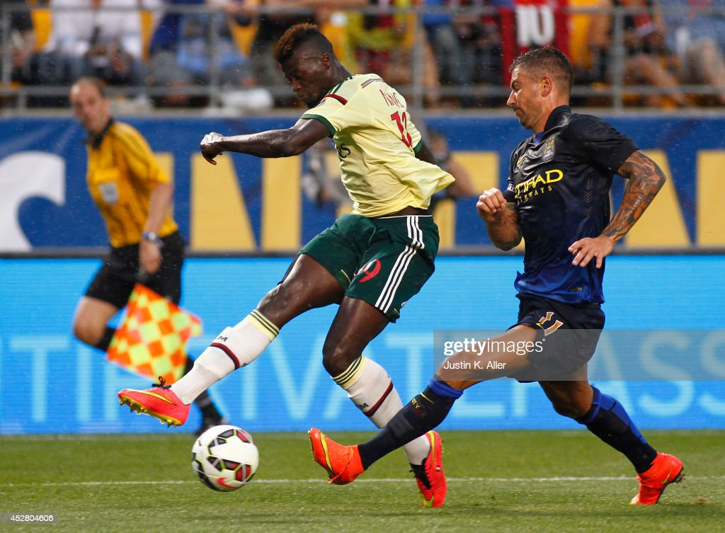 <a gi-track='captionPersonalityLinkClicked' href=/galleries/search?phrase=M%27Baye+Niang&family=editorial&specificpeople=7755200 ng-click='$event.stopPropagation()'>M'Baye Niang</a> #19 of AC Milan handles the ball against <a gi-track='captionPersonalityLinkClicked' href=/galleries/search?phrase=Aleksandar+Kolarov&family=editorial&specificpeople=4329824 ng-click='$event.stopPropagation()'>Aleksandar Kolarov</a> #11 of Manchester City during International Champions Cup 2014 at Heinz Field on July 27, 2014 in Pittsburgh, Pennsylvania.
