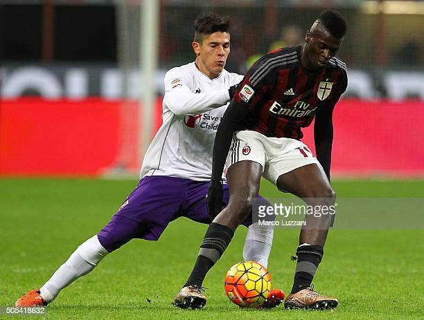 Baye Niang of AC Milan is challenged by Facundo Roncaglia of ACF Fiorentina during the Serie A match between AC Milan and ACF Fiorentina at Stadio...