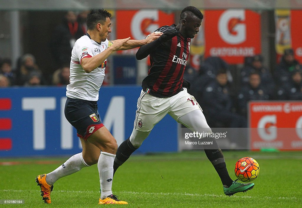 M Baye Niang (R) of AC Milan is challenged by Nicolas Andres Burdisso (L) of Genoa CFC during the Serie A match between AC Milan and Genoa CFC at Stadio Giuseppe Meazza on February 14, 2016 in Milan, Italy.