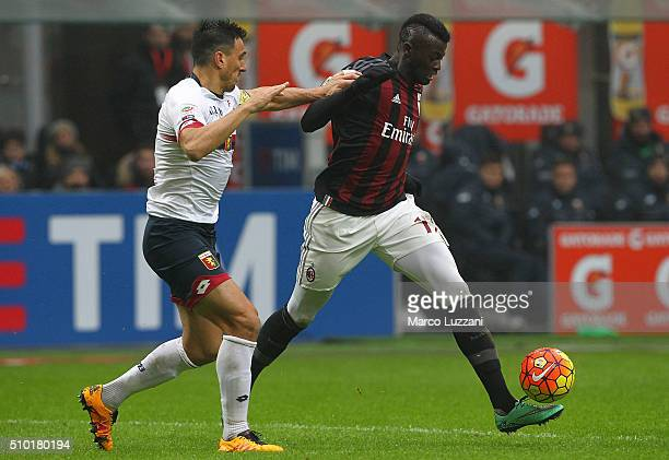 Baye Niang of AC Milan is challenged by Nicolas Andres Burdisso of Genoa CFC during the Serie A match between AC Milan and Genoa CFC at Stadio...