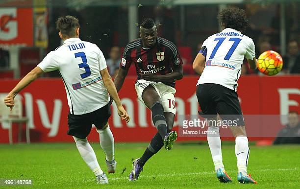 Baye Niang of AC Milan is challenged by Rafael Toloi and Cristin Raimondi of Atalanta BC during the Serie A match between AC Milan and Atalanta BC at...