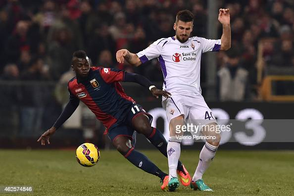 Baye Niang of Genoa CFC clashes with Nenad Tomovic of ACF Fiorentina during the Serie A match between Genoa CFC and ACF Fiorentina at Stadio Luigi...