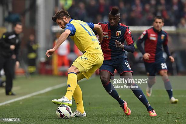 Baye Niang of Genoa CFC is challenged by Bostjan Cesar of AC Chievo Verona during the Serie A match between Genoa CFC and AC Chievo Verona at Stadio...