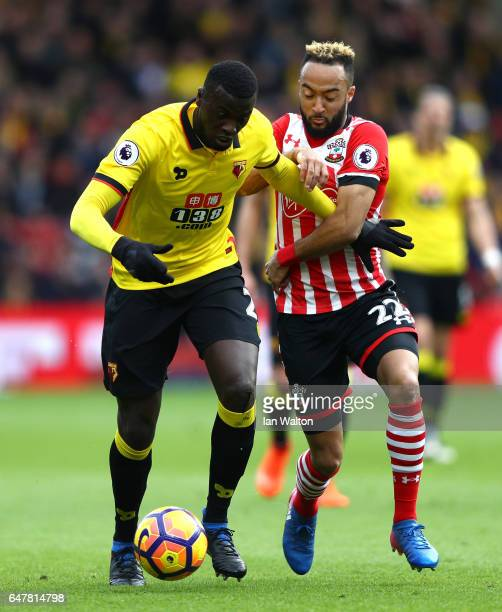 Baye Niang of Watford and Nathan Redmond of Southampton battle for possession during the Premier League match between Watford and Southampton at...