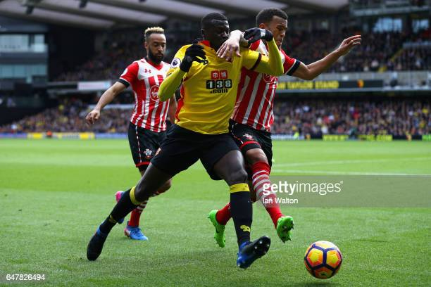 Baye Niang of Watford and Ryan Bertrand of Southampton battle for possession during the Premier League match between Watford and Southampton at...