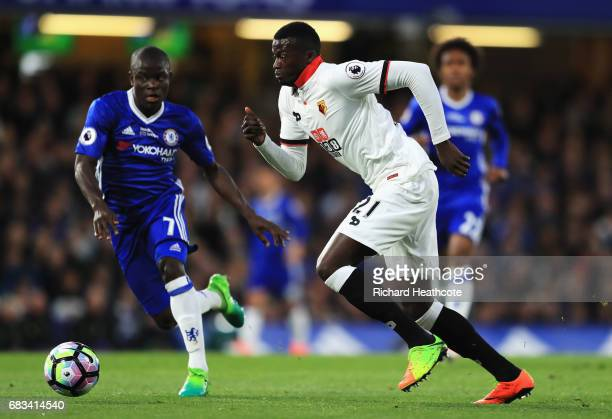 Baye Niang of Watford attempts to get past N'Golo Kante of Chelsea during the Premier League match between Chelsea and Watford at Stamford Bridge on...