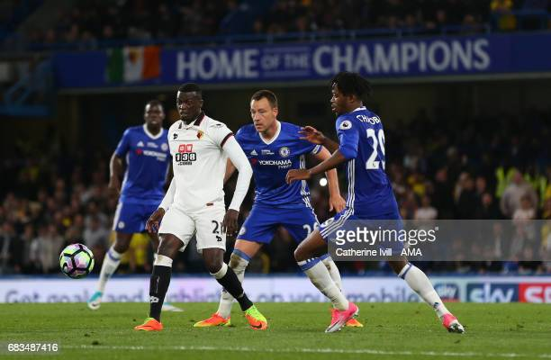 Baye Niang of Watford battles with John Terry and Nathaniel Chalobah of Chelsea during the Premier League match between Chelsea and Watford at...