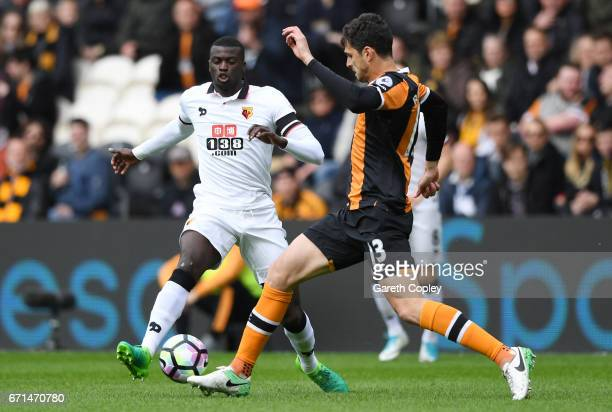 Baye Niang of Watford is closed down by Andrea Ranocchia of Hull City during the Premier League match between Hull City and Watford at the KCOM...