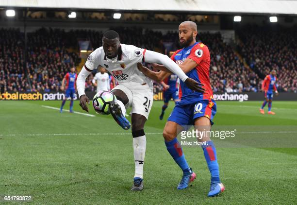 Baye Niang of Watford is put under pressure from Andros Townsend of Crystal Palace during the Premier League match between Crystal Palace and Watford...