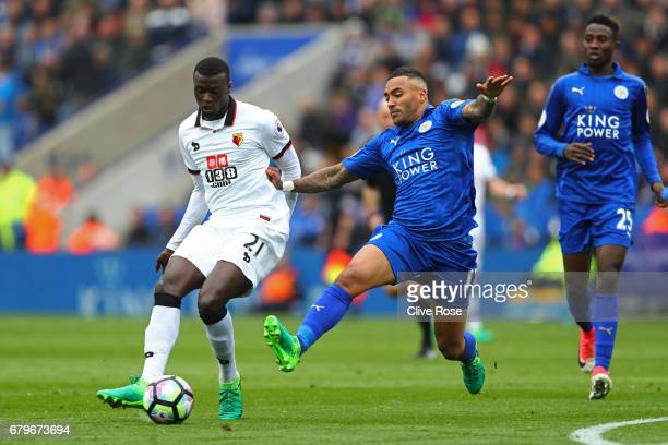 Baye Niang of Watford is put under pressure from Danny Simpson of Leicester City during the Premier League match between Leicester City and Watford...