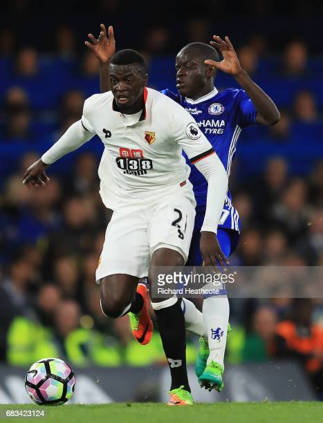 Baye Niang of Watford is put under pressure from N'Golo Kante of Chelsea during the Premier League match between Chelsea and Watford at Stamford...