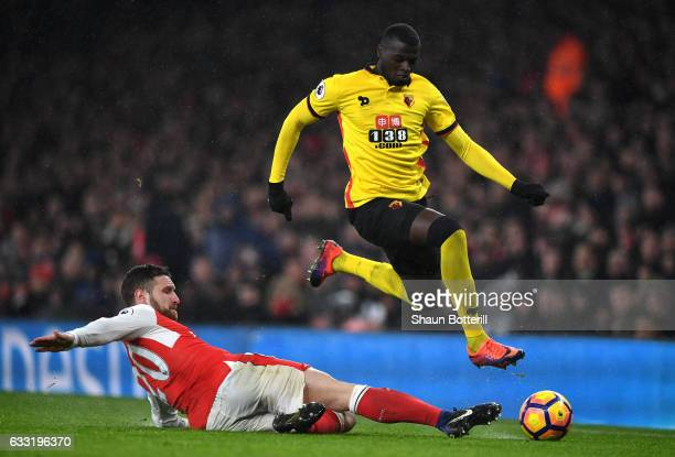 Baye Niang of Watford runs with the ball past Shkodran Mustafi of Arsenal during the Premier League match between Arsenal and Watford at Emirates...