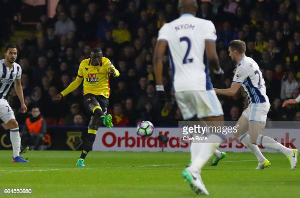 Baye Niang of Watford scores his sides first goal during the Premier League match between Watford and West Bromwich Albion at Vicarage Road on April...