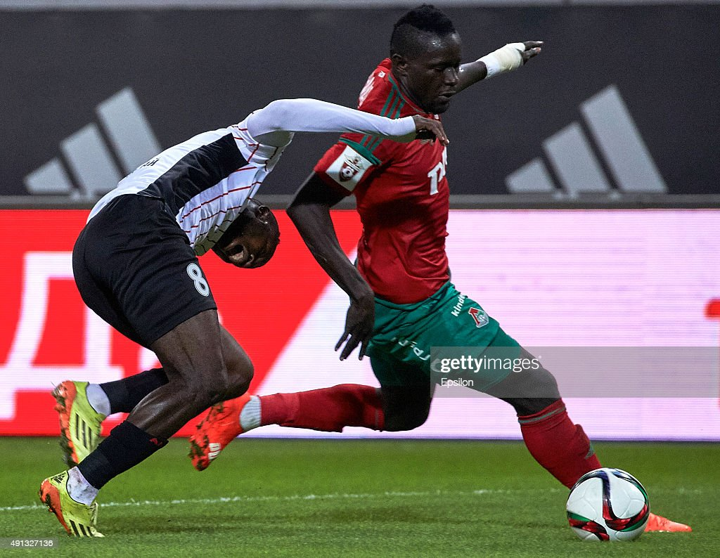 Baye Oumar Niasse of FC Lokomotiv Moscow challenged by <a gi-track='captionPersonalityLinkClicked' href=/galleries/search?phrase=Fegor+Ogude&family=editorial&specificpeople=7917446 ng-click='$event.stopPropagation()'>Fegor Ogude</a> of FC Amkar Perm during the Russian Premier League match betweenFC Lokomotiv Moscow and FC Amkar Perm at Lokomotiv stadium on October 4, 2015 in Moscow, Russia.