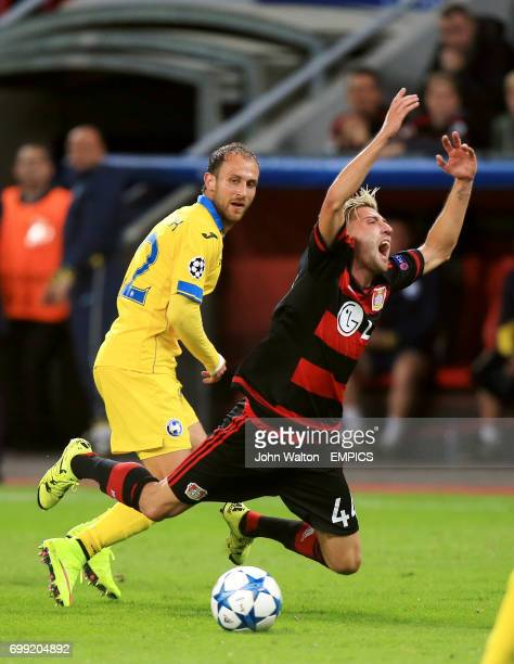 Bayer 04 Leverkusen's Kevin Kampl takes a tumble after a challenge by BATE Borisov's Igor Stasevich