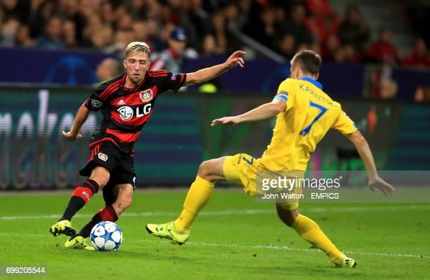 Bayer 04 Leverkusen's Kevin Kampl takes on BATE Borisov's Aleksandr Karnitski