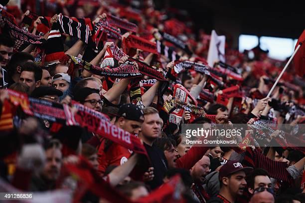Bayer Leverkusen supporters are seen during the Bundesliga match between Bayer Leverkusen and FC Augsburg at BayArena on October 4 2015 in Leverkusen...