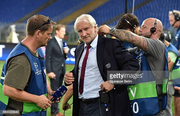 Bayer Leverkusen team manager Rudi Voeller looks on before the UEFA Champions League qualifying round play off first leg match between SS Lazio and...