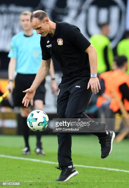 Bayer Leverkusen's coach from Germany Heiko Herrlich reacts during the German First division Bundesliga football match Bayer Leverkusen vs VfL...