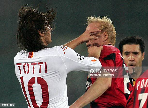 Bayer Leverkusen's defender and captain Carsten Ramelow clashes with AS Roma's captain Francesco Totti during their Champions League group B football...