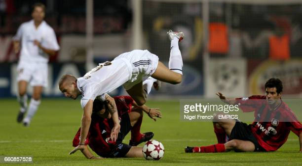 Bayer Leverkusen's Diego Placente tackles Real Madrid's David Beckham