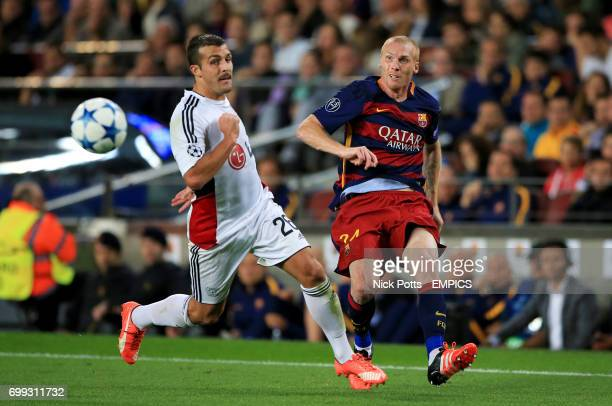Bayer Leverkusen's Giulio Donati and Barcelona's Jeremy Mathieu in action