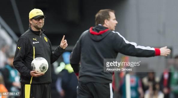 Bayer Leverkusen's head coach Sascha Lewandowski and Juergen Klopp head coach of Borussia Dortmund in action during the Bundesliga match between...