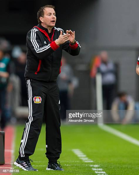 Bayer Leverkusen's head coach Sascha Lewandowski encourages his players during the Bundesliga match between Bayer Leverkusen and Borussia Dortmund at...
