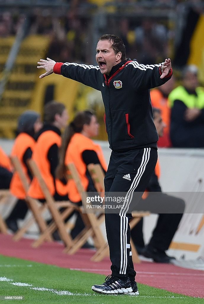 Bayer Leverkusen's interim coach <a gi-track='captionPersonalityLinkClicked' href=/galleries/search?phrase=Sascha+Lewandowski&family=editorial&specificpeople=5134760 ng-click='$event.stopPropagation()'>Sascha Lewandowski</a> reacts during the German first division Bundesliga football match between Bayer Leverkusen and Dortmund on April 26, 2014 in Leverkusen, western Germany.