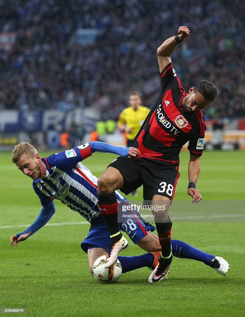 Bayer Leverkusen's Karim Bellarabi (R) in action with Berlin's Fabian Lustenberger (L) during the Bundesliga soccer match between Bayer Leverkusen and Hertha Berlin at the BayArena in Leverkusen, Germany on April 30, 2016.