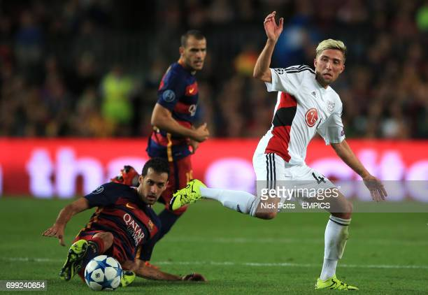 Bayer Leverkusen's Kevin Kampl is tackled by Barcelona's Sergio Busquets