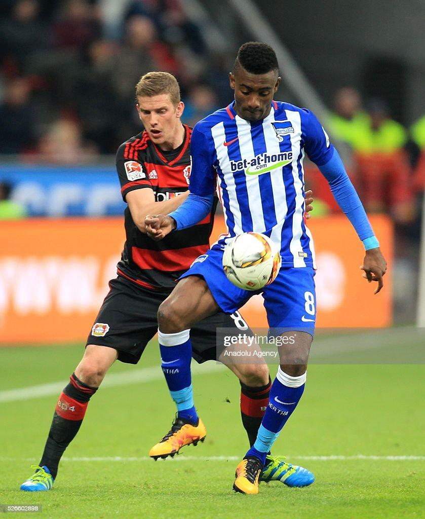 Bayer Leverkusen's Lars Bender (L) in action with Hertha Berlin's Salomon Kalou (R) during the Bundesliga soccer match between Bayer Leverkusen and Hertha Berlin at the BayArena in Leverkusen, Germany on April 30, 2016.