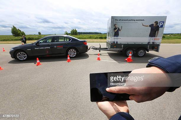 A Bayerische Motoren Werke AG automobile is parked via a mobile device remote control during a smart trailer parking demonstration at the Robert...