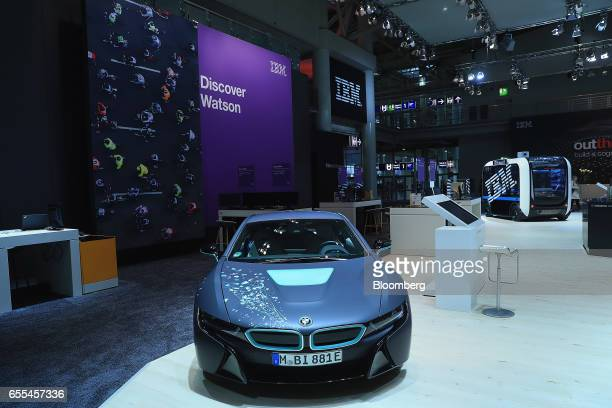A Bayerische Motoren Werke AG i8 electric vehicle promoting IBM Watson technology sits on display in the International Business Machines Corp...