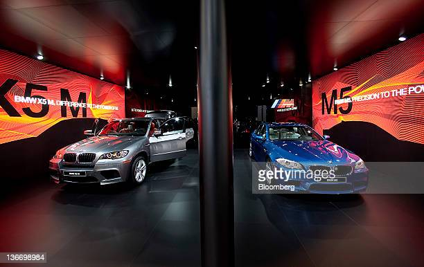 Bayerische Motoren Werke AG X5 and M5 vehicles are displayed during the 2012 North American International Auto Show in Detroit Michigan US on Tuesday...