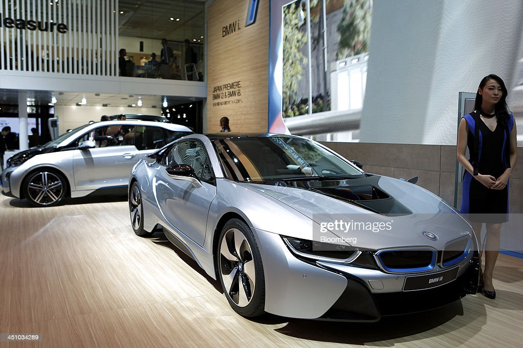 Bayerische Motoren Werke AG's (BMW) i8 electric sports vehicle, right, and i3 electric vehicle sit on display at the 43rd Tokyo Motor Show 2013 in Tokyo, Japan, on Thursday, Nov. 21, 2013. The autoshow will be open to the public from Nov. 23 to Dec. 1 at the Tokyo International Exhibition Center, also known as the Tokyo Big Sight. Photographer: Kiyoshi Ota/Bloomberg via Getty Images