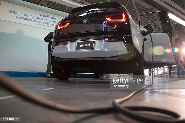 A Bayerische Motoren Werke i3 electric car is charged during a ceremony to mark the launch of electric vehicle charging stations in Mexico City...