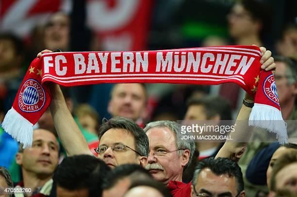 A Bayern fan waves a scarf prior to the UEFA Champions League secondleg quarterfinal football match Bayern Munich v FC Porto in Munich southern...