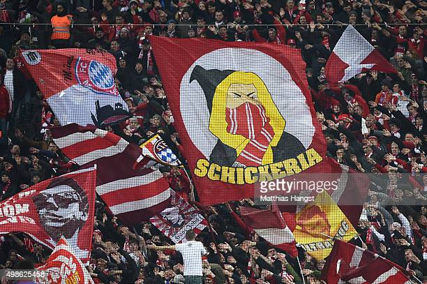 Bayern fans cheer on their team during the UEFA Champions League group F match between FC Bayern Munchen and Olympiacos FC at the Allianz Arena on...