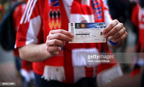 Bayern fans display their match tickets prior to the UEFA Champions League Quarter Final first leg match between Manchester United and FC Bayern...