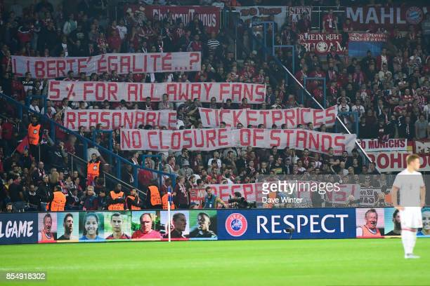 Bayern fans hold up a banner protesting ticket prices and allocation during the Uefa Champions League match between Paris Saint Germain and FC Bayern...