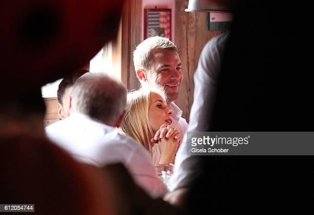 Bayern goal keeper Manuel Neuer and his girlfriend Nina Weiss attend the 'FC Bayern Wies'n' during the Oktoberfest at Kaeferschaenke / Theresienwiese...