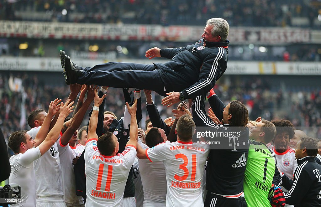 FC Bayern Muenchen celebrate winning the Bundesliga by throwing head coach <a gi-track='captionPersonalityLinkClicked' href=/galleries/search?phrase=Jupp+Heynckes&family=editorial&specificpeople=2062040 ng-click='$event.stopPropagation()'>Jupp Heynckes</a> into the air after the match between Eintracht Frankfurt and FC Bayern Muenchen at the Commerzbank-Arena on April 6, 2013 in Frankfurt am Main, Germany.