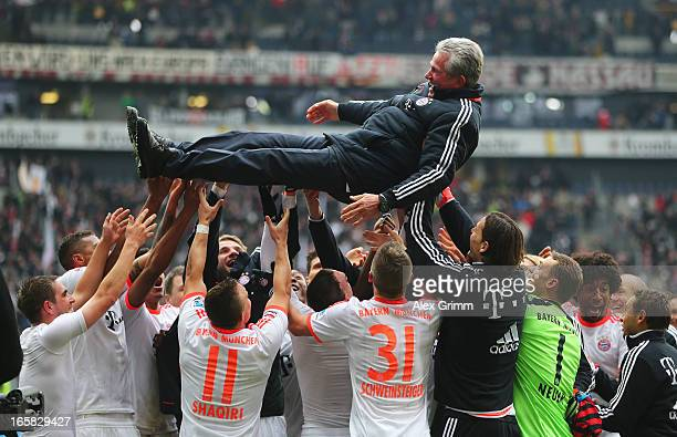 Bayern Muenchen celebrate winning the Bundesliga by throwing head coach Jupp Heynckes into the air after the match between Eintracht Frankfurt and FC...